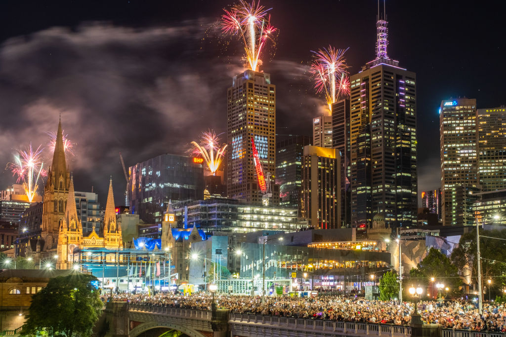 Fireworks erupt over the Melbourne central business district during New Year