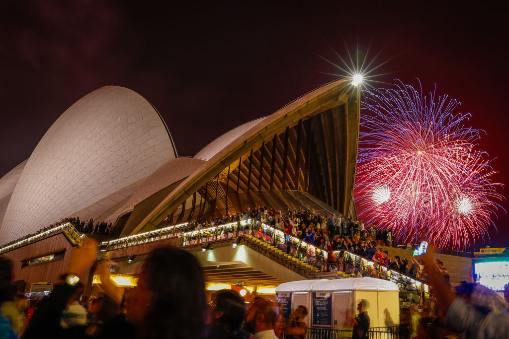 Fireworks explode over the Sydney Harbour Bridge and Sydney Opera House during the midnight display during New Year