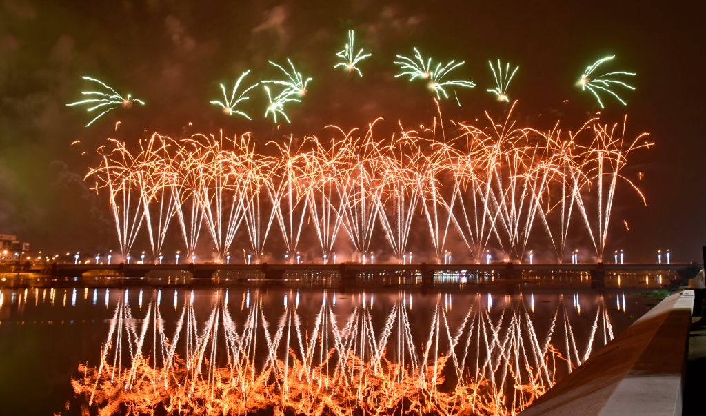 Fireworks light up the sky over the General de Gaulle bridge and the Ebrie lagoon during New Year