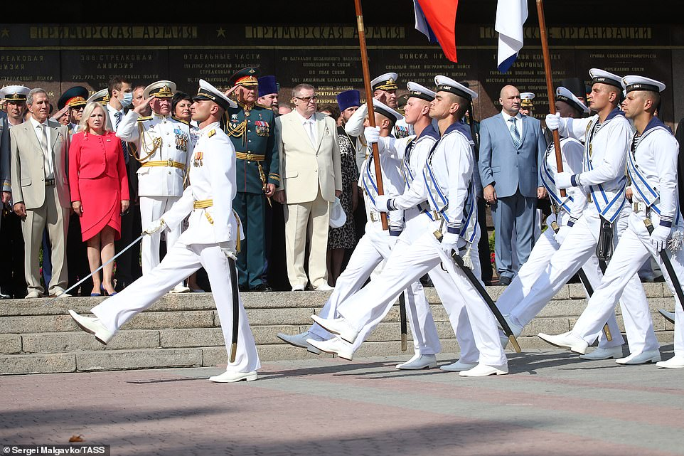 Russian servicemen march during a military parade on Russian Navy Day. The event is traditionally celebrated on the last Sunday of July