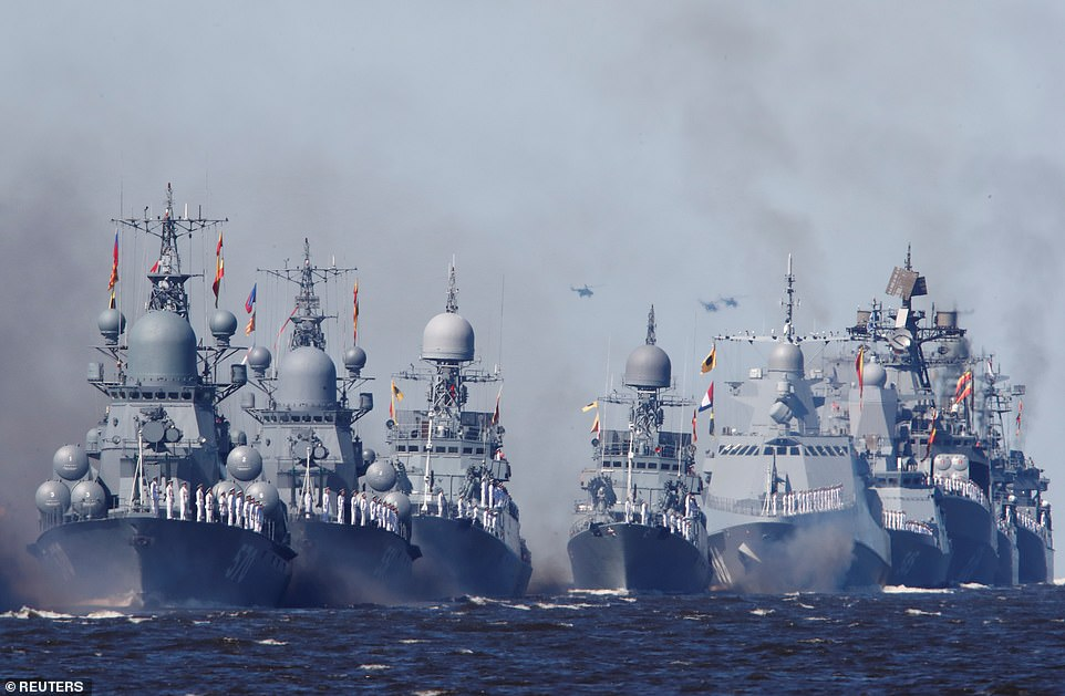 Russian warships sail during the Navy Day parade in Kronstadt near Saint Petersburg, Russia, today as part of the day