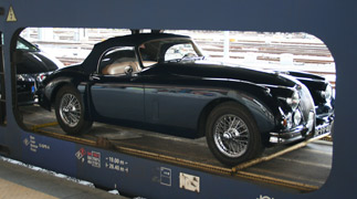 A classic Jaguar takes the train to Italy...